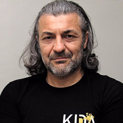 M. Enis Tayman